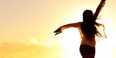 11900499 - carefree woman dancing in the sunset on the beach. vacation vitality healthy living concept